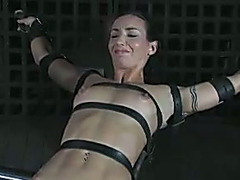 Crucified dark brown beauty with miniature mangos receives steel toy in her holes