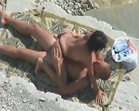 This woman appears to be to be obsessed with her hubby's hard schlong on the beach