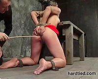 Gagged short-haired whore enjoys a lot of tortures in BDSM clip