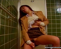 Asian coed in plaid petticoat is masturbating in the toilet room