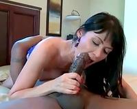 Busty brunette hair enjoying a thick dark shaft
