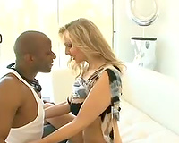 Julia Ann sucks a large dark dick