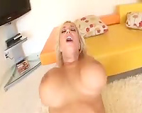 Busty golden-haired bombshell bounces on thick dark weenie