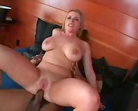 Nice knockers on a blond having interracial sex