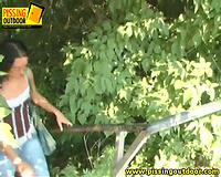 Sexy brunette hair playgirl in jeans can't live without pissing on the stairs