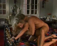 Busty golden-haired babe rides hard pecker previous to getting screwed doggy style