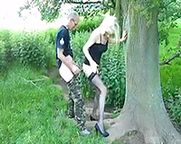 Svelte lusty pale golden-haired head was leaned over the tree and screwed from behind