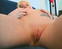 Gorgeous golden-haired tattoed sweety dildos her own drooling vagina