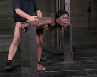 Tied up slim black nympho acquires her slit hammered from behind