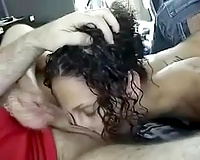 Curly-haired bitch gives her guy a worthwhile oral-service in his car