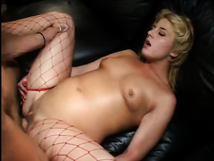 Sweet and hot blond floozy in red fishnet nylons