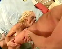Hot blond in sexy nylons rides her lover's knob in cowgirl position