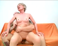 Short-haired old spinner sucks a pecker and takes a ride on it