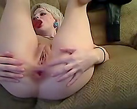 Prurient web camera model with tattoos copulates her backdoor with her red sextoy