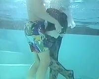 Red head indecent slut sucks pecker below water in pool