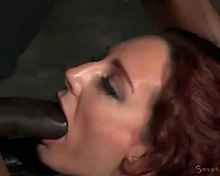 Redhead milf dominatrix manacled to the bars and facefucked with BBC