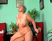 Busty and voracious granny sucks and rides a younger guy