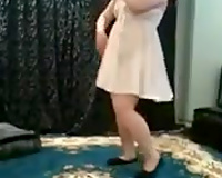 Chubby Egyptian girlfriend dancing seductively in white suit