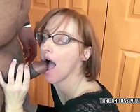 Slender nerdy redhead whore is going down on a unbending dick