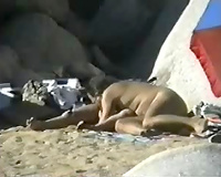 One lewd older pair having hot time on the beach - spy vid