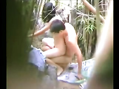 Chinese pair caught fucking in the bamboo bushes