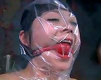 Wicked dominatrix-bitch puts a plastic bag over her slave's head