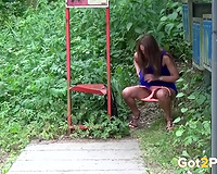 Brunette sweetheart on the bus stop spraying urine in the bushes