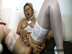 My wife looks fucking sexy in white nylons and prefers fisting
