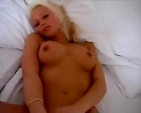 Incredibly sexy white blondie with her lover on the sofa