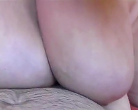 Mature floozy with heaving breasts gives astonishing oral job and titjob