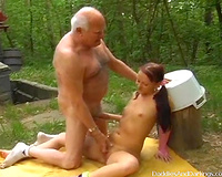 Grandpa screwed a sexy and youthful doxy in her love tunnel on the ground