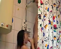Zealous slim black haired girlie was drilled in the bath