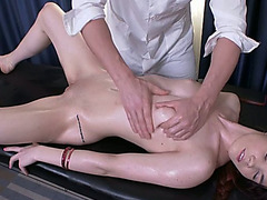 Sensual and juvenile redhead playgirl on the massage table