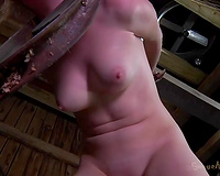 Buxom moaning light haired doxy receives fixed with ropes to bars