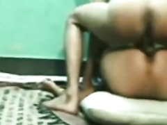 Rough missionary style sex session of a young Indian pair