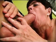 Short-haired aged whore sucks a fat jock and takes a ride on it