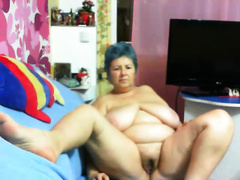 Blue haired overweight slutty wife with large boobies was teasing her own unsightly vagina