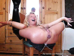 Flexible blonde haired MILFie nympho in high boots receives holes fucked with toy