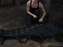 This leather sleep sack is very taut on slave's body