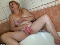big beautiful woman dilettante blond lady in the bathtub washing and masturbating