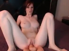 This camgirl has no problem stretching her cunt with her giant sex toy