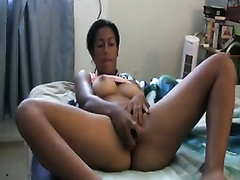Busty dilettante mamma masturbating with smooth sex toy during the time that on livecam with me