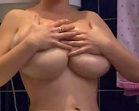 Outrageous dark brown hottie with huge boobies oils up herself