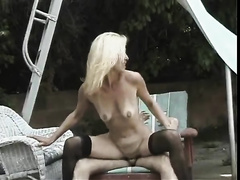 Hot and slim blond milf on the lounger riding a white shlong