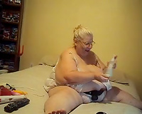 My beloved big beautiful woman granny in her bed once more masturbating with a dong