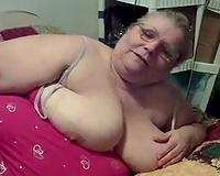 Slutty and freaky older slut teases herself on web camera
