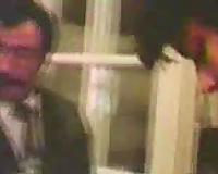 Retro homemade movie scene of my parents having a sex party