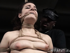 Sitting with stretched apart legs bound up dark head is teased in BDSM mode