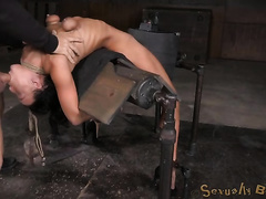 Flexible bent over yielding brunette receives throat drilled hard