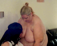 Here that babe is once more feeding a lesbo with her large boobies